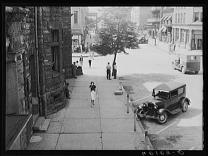 Shady side of main street, Elkins, West Virginia. Photo by John Vachon, from the Library of Congress.