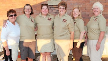 Some of the volunteers and board members of the Elkins Depot Welcome Center at one of our summer concert series events.