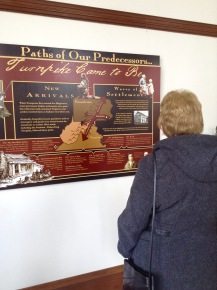 Elaine Valentine learning the history of Beverly from the Heritage Center exhibit